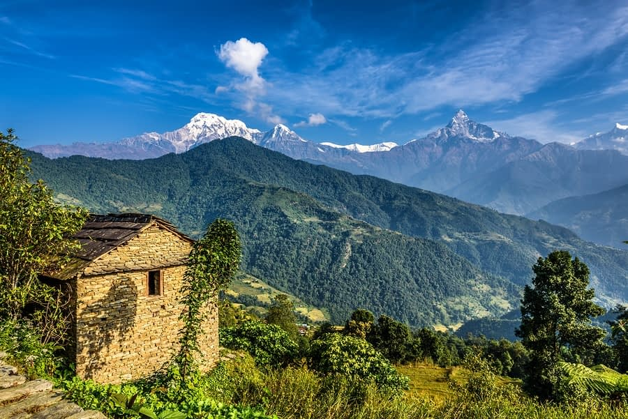Himalaya mountains and old stone cabin near Pokhara in Nepal